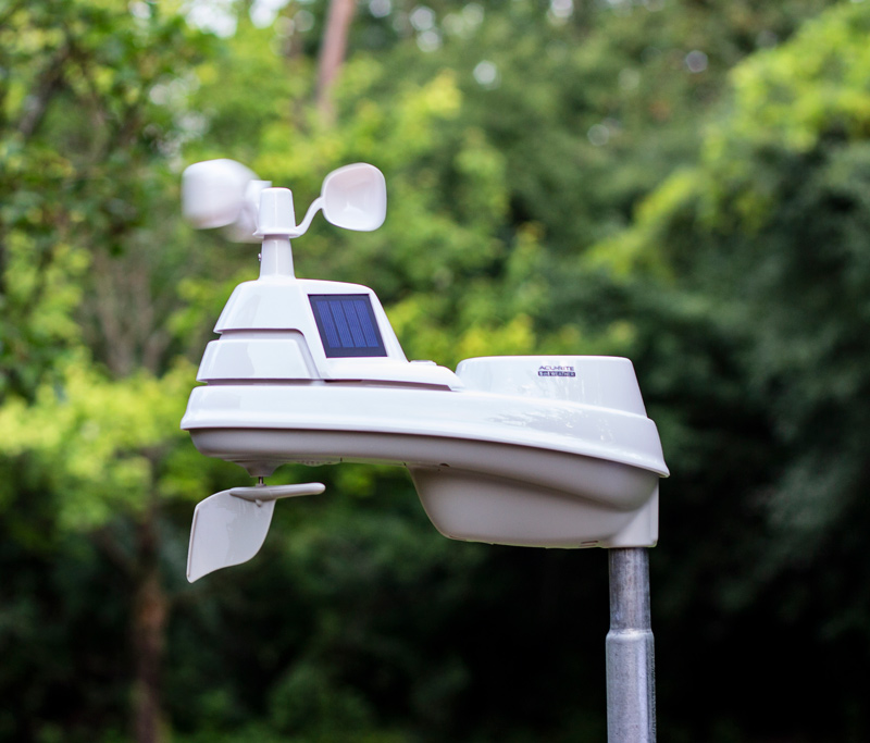 AcuRite outdoor weather sensor in a backyard