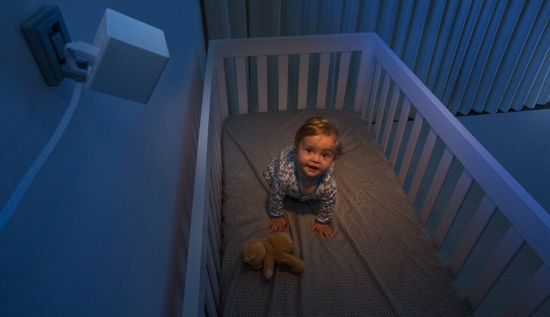 Baby in a crib at night