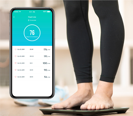 Wyze Smart Scale assessing person with results displaying on phone app