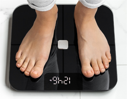 Person Standing on Wyze Smart Scale